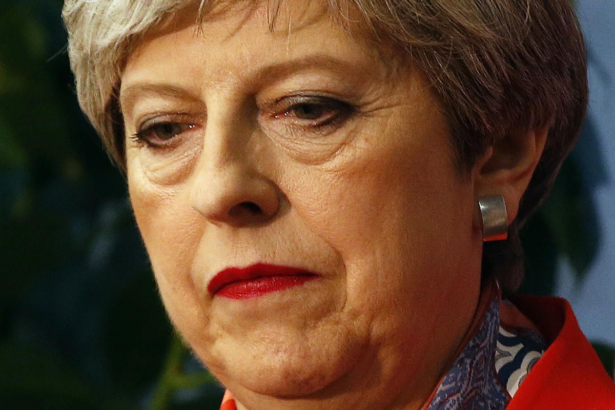 Britain's Prime Minister Theresa May listens as the declaration at her constituency is made for in the general election in Maidenhead, England, Friday, June 9, 2017. British Prime Minister Theresa May's gamble in calling an early election appeared Friday