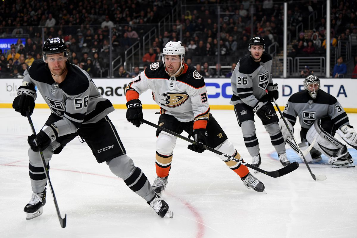 Nick Ritchie #37 of the Anaheim Ducks skates after the puck between Kurtis MacDermid #56 and Sean Walker #26 of the Los Angeles Kings during a 3-1 Ducks win over the Kings at Staples Center on February 01, 2020 in Los Angeles, California.