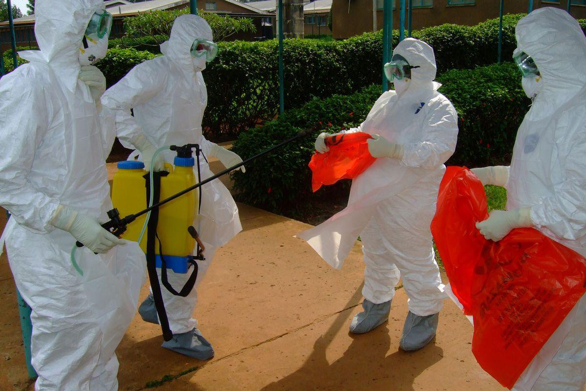 World Health Organization officials prepare to enter a hospital during a 2012 Ebola outbreak in Uganda.