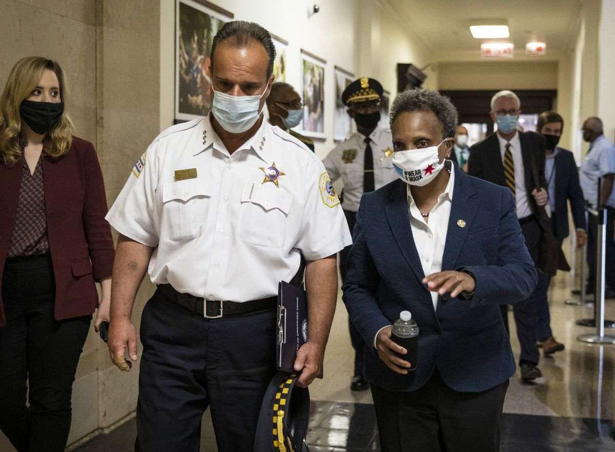 First Deputy Police Superintendent Anthony Riccio and Mayor Lori Lightfoot after a news conference last Thursday about Chicago police officers who remained in U.S. Rep. Bobby Rush's  campaign office while looters hit nearby stores.