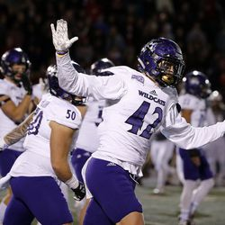 The Weber State Wildcats celebrate a third down stop against the Southern Utah Thunderbirds during NCAA football in Cedar City on Saturday, Dec. 2, 2017.