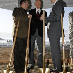 """Harvey Davis, associate director for installations and logistics at the National Security Agency, Sen. Orrin Hatch and John """"Chris"""" Inglis, deputy director of the National Security Agency, talk after shoveling dirt during the groundbreaking ceremony for the first Intelligence Community Comprehensive National Cybersecurity Initiative (CNCI) Data Center at Camp Williams, Utah on Thursday, Jan. 6, 2011."""