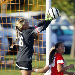 American Fork goalkeeper Savanna Empey (66) punches the ball away from goal against Davis during the 5A girls soccer playoffs in Kaysville, Thursday, Oct. 15, 2015.