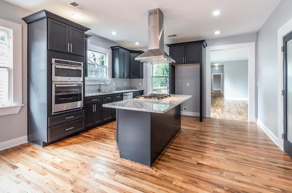 A new kitchen in an older home with woods floors.
