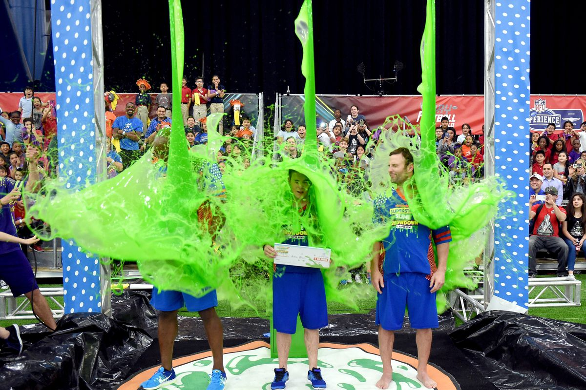 NFL player DeMarcus Ware, actor Ricardo Hurtado, and NFL player Wes Welker at the taping of Nickelodeon's Superstar Slime Showdown at Super Bowl in Houston, Texas, premiering Sunday, Feb. 5, at 12pm (ET/PT).