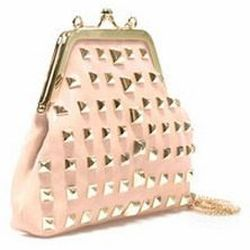 "<a href=""http://www.zara.com/webapp/wcs/stores/servlet/product/us/en/zara-us-S2012/209502/878578/MINI%2BMESSENGER%2BBAG%2BWITH%2BSTUDS%2BAND%2BCLASP%2BFASTENING""> Zara mini-messenger bag with with stud and clasp fastening</a>, $89.90 zara.com"