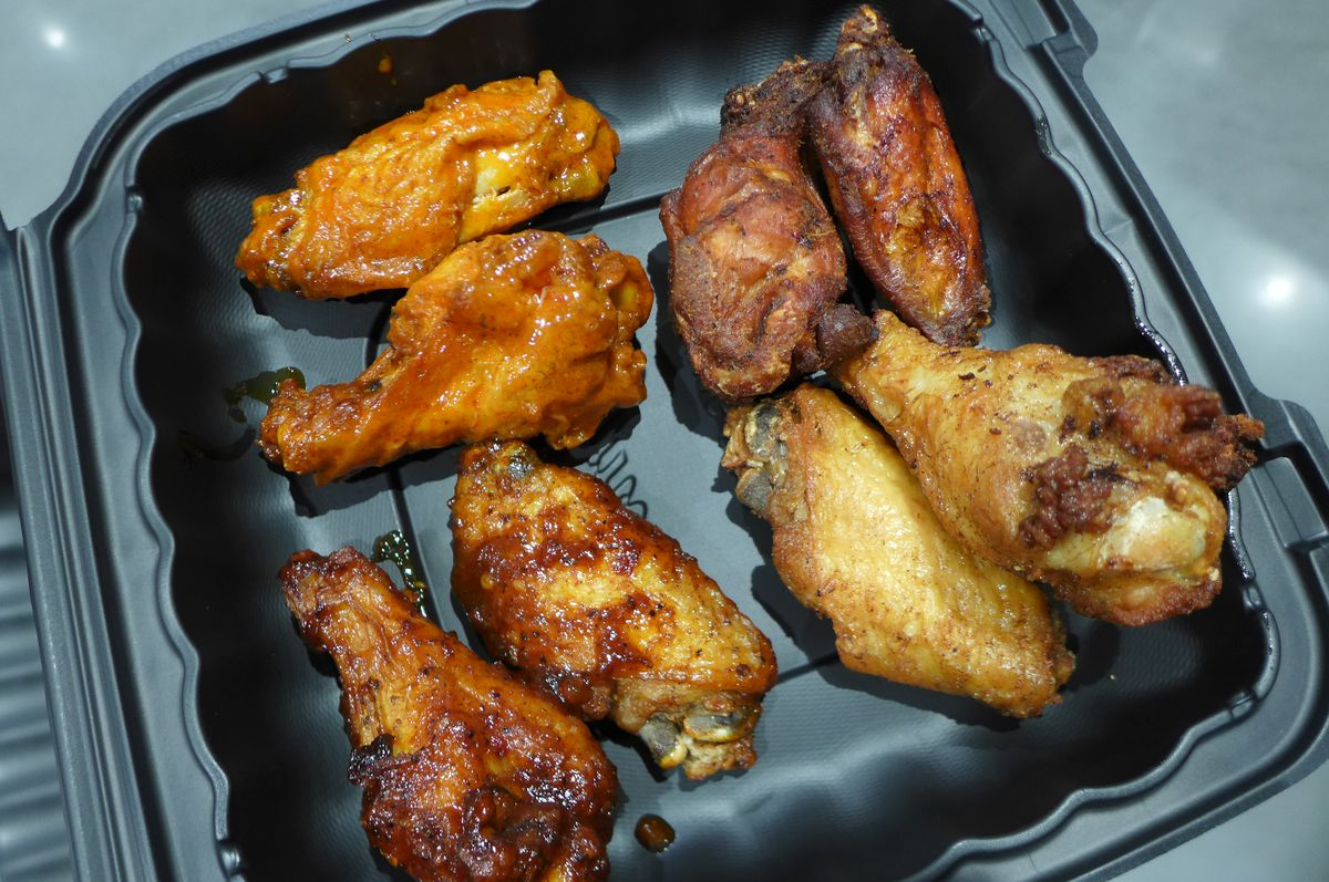 Four types of fried chicken wings, two of each, and all look slightly different.