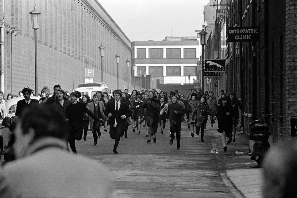 Beatles flee fans Hard Day's Night