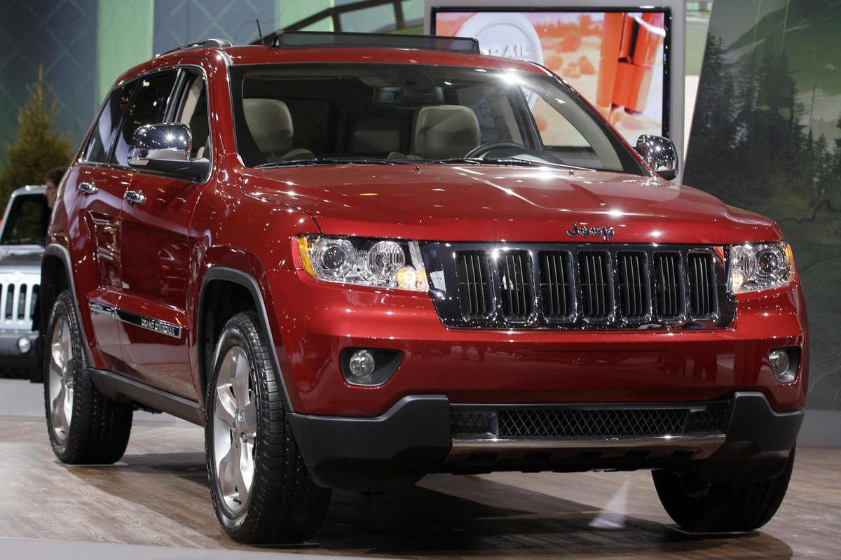 FILE - In a Wednesday, Feb. 8, 2012 file photo, Jeep introduces the Jeep Grand Cherokee during the media preview of the Chicago Auto Show at McCormick Place in Chicago. Sales of Jeep Grand Cherokee and Dodge Durango SUVs are so strong that their factory w