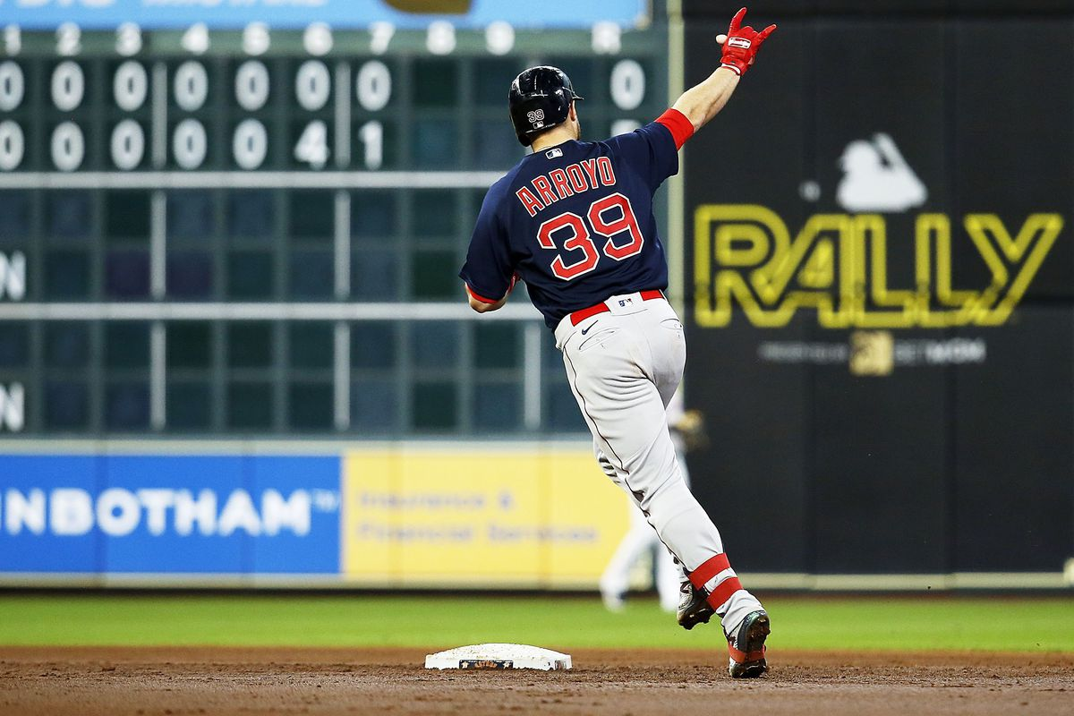: Christian Arroyo #39 of the Boston Red Sox hits a three run home run in the second inning against the Houston Astros at Minute Maid Park on June 03, 2021 in Houston, Texas.