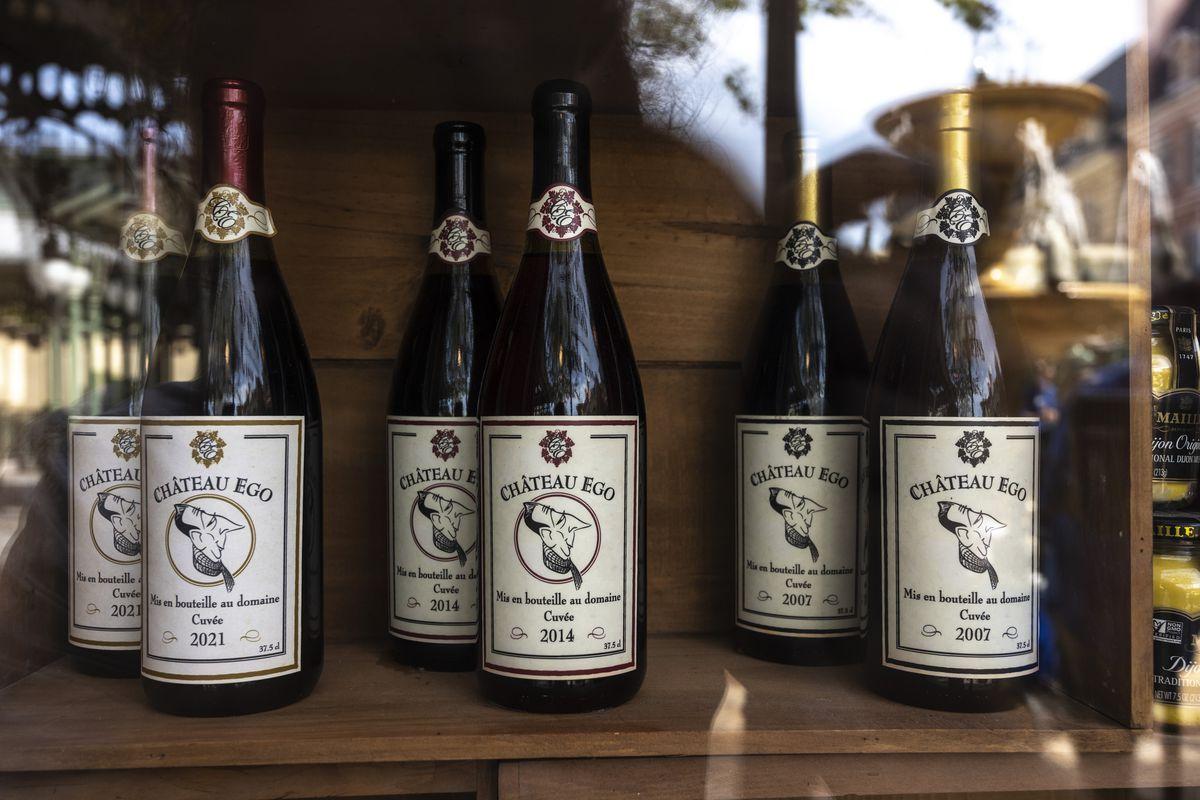 Bottles of wine labeled Chateau Ego on a shelf