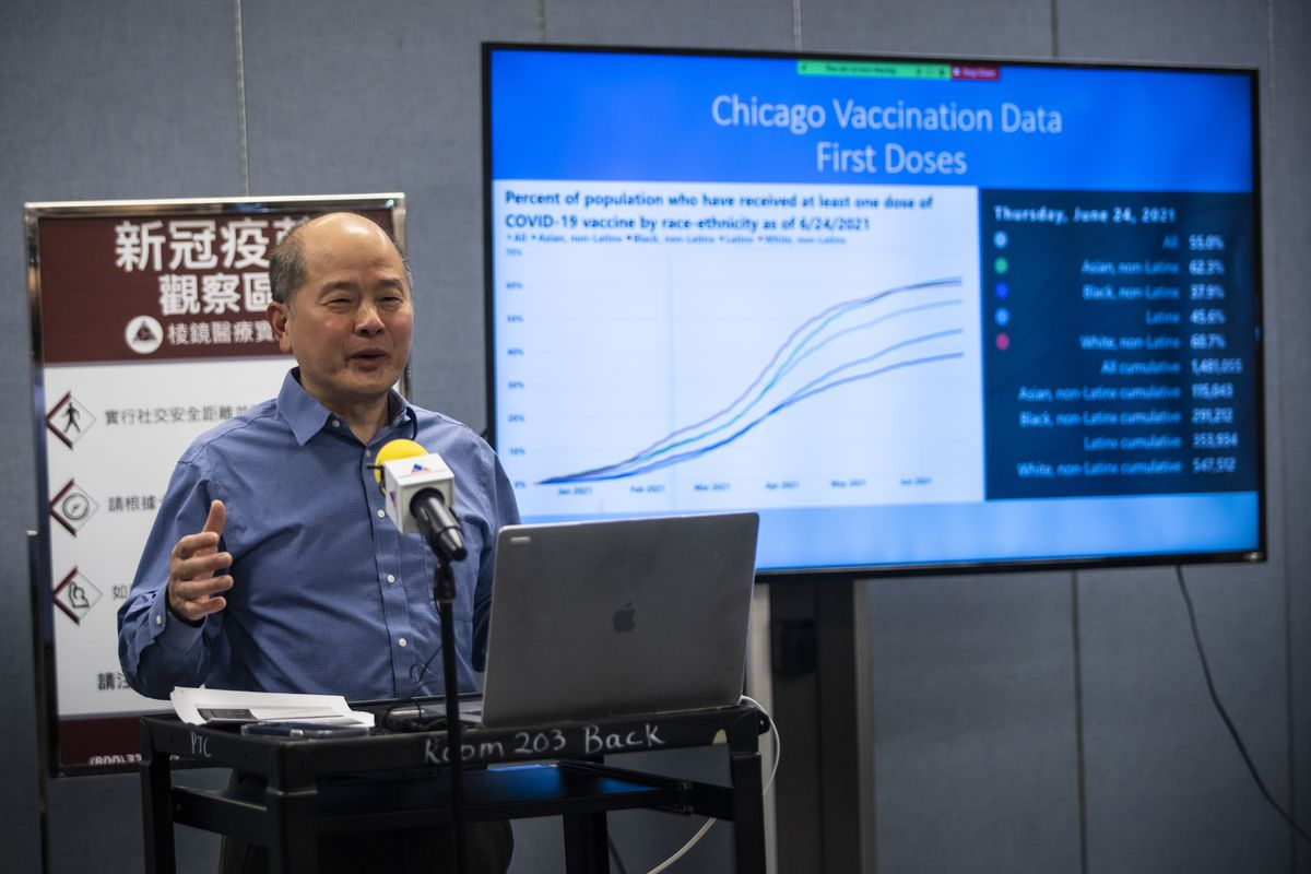 David Wu, executive director of the Pui Tak Center, discusses COVID-19 vaccinations Monday during a news conference at the center in Chinatown.