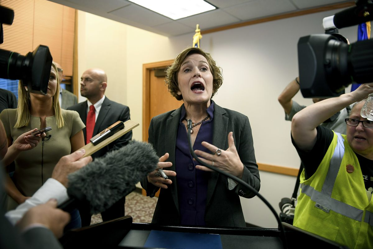 Minneapolis Mayor Betsy Hodges tries to talk to the media as she is shouted at by protesters during her press conference held to discuss the resignation of Minneapolis Police Chief Janee Harteau, at City Hall on Friday. Harteau resigned Friday at the requ