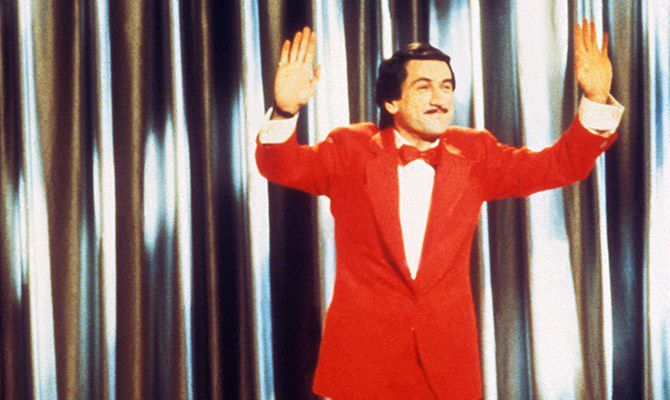 De Niro, sporting a red suit, in The King of Comedy.
