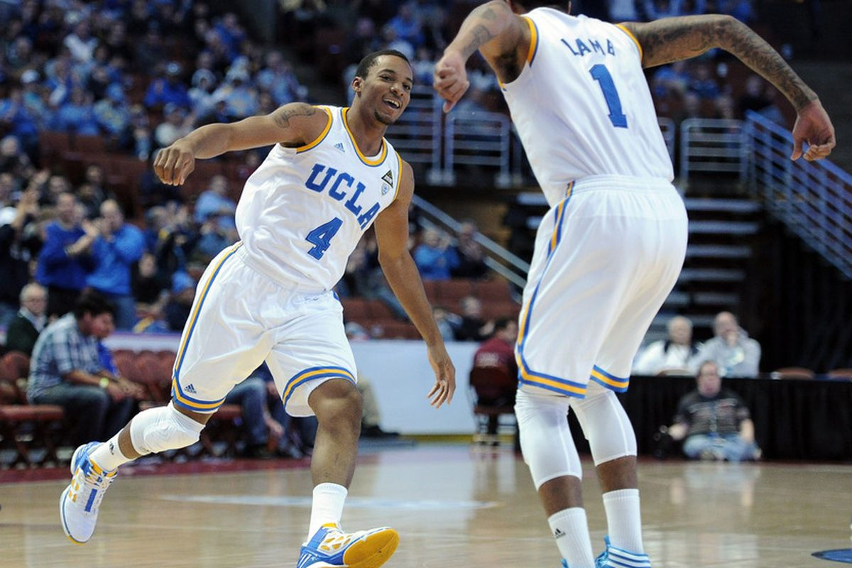 ANAHEIM, CA - DECEMBER 17:  Norman Powell #4 of UCLA Bruins celebrates his dunk with Tyler Lamb #1 during the second half against the UC Davis Aggies at Honda Center on December 17, 2011 in Anaheim, California.  (Photo by Harry How/Getty Images)