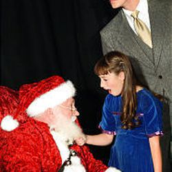 """Art Fenstermaker as Kris Kringle, with Jackson Westenskow as Fred Gailey and Lark Barney as Susan Walker in the Alpine Playhouse production of """"Here's Love."""""""
