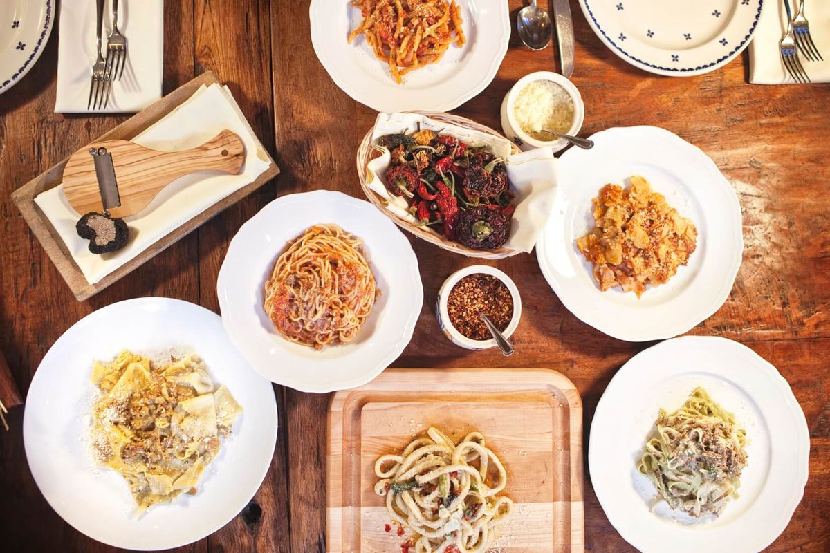 several plates of pasta on a table