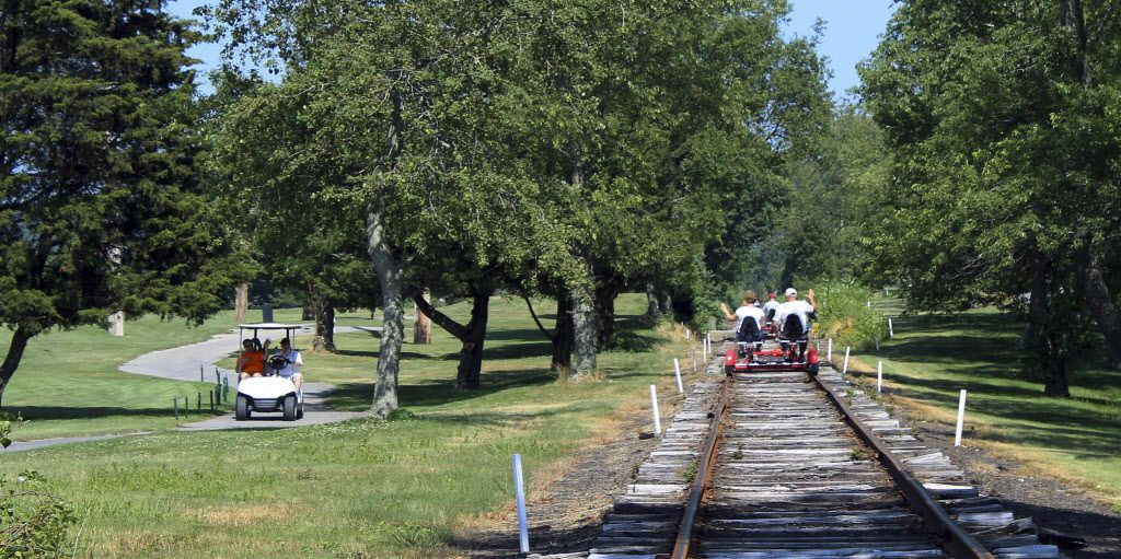 A Rail Explorers tour passes through the grounds for the Montaup Country Club in Portsmouth, R.I. Rail Explorers opened in Portsmouth in April as part of the Newport and Narragansett Bay Railroad. | AP Photo/Jennifer McDermott