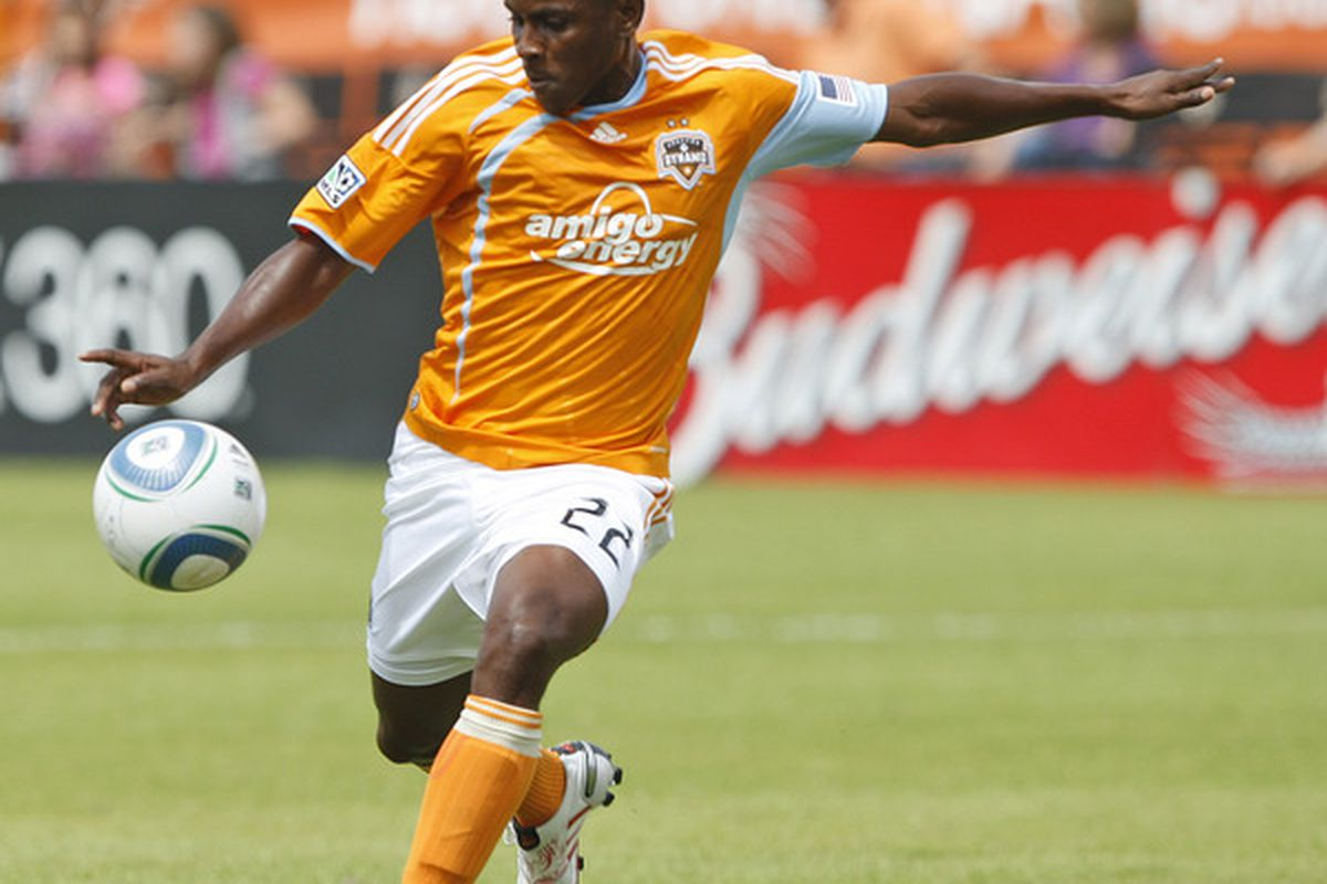 HOUSTON - APRIL 17:  Lovel Palmer #22 of the Houston Dynamo launches a shot from 40 yards out for a goal against Chivas USA at Robertson Stadium on April 17, 2010 in Houston, Texas.  (Photo by Bob Levey/Getty Images)