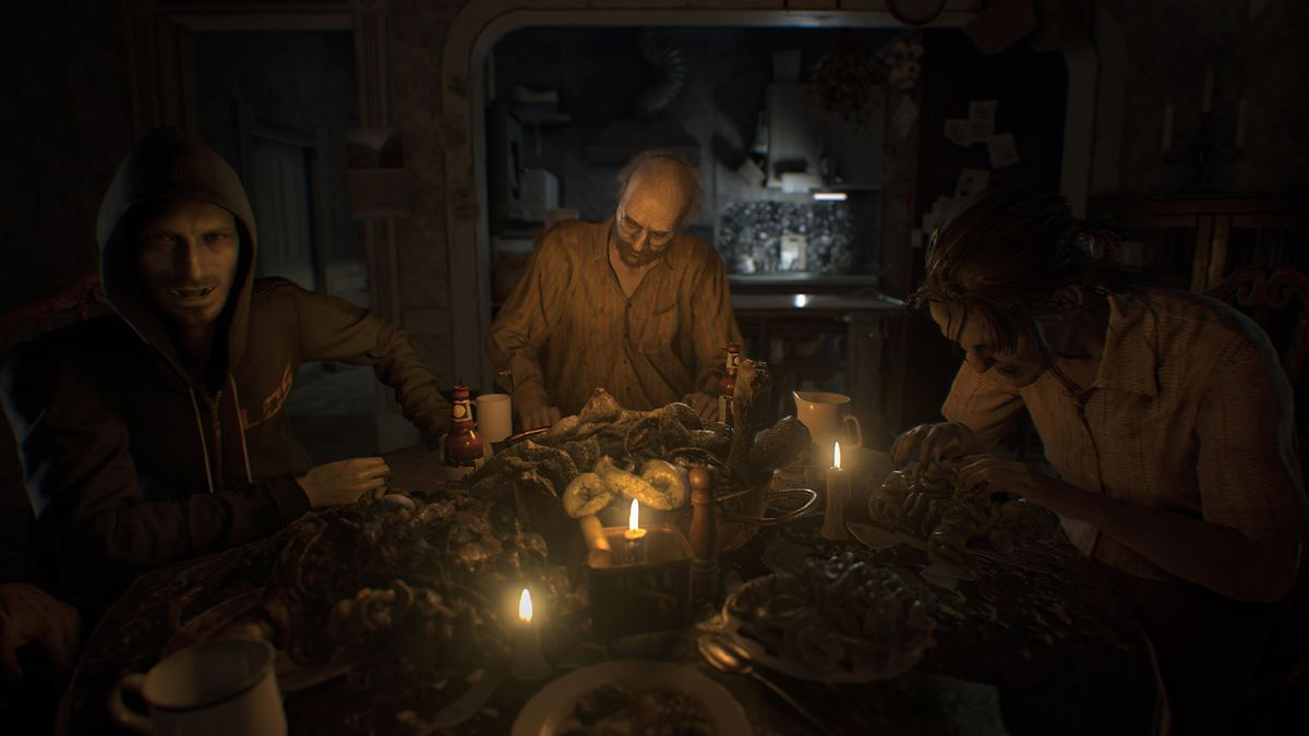 In this Resident Evil 7 screenshot, the player character is at a table. Seated around him are members of the evil family that has kidnapped him, including Jack, Marguerite and Lucas. The table in front of them is full of disgusting looking food in the for
