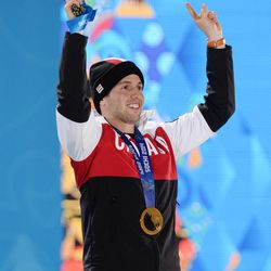 Alex Bilodeau (CAN) celebrates after receiving his gold medal during the medal ceremony for the men's moguls