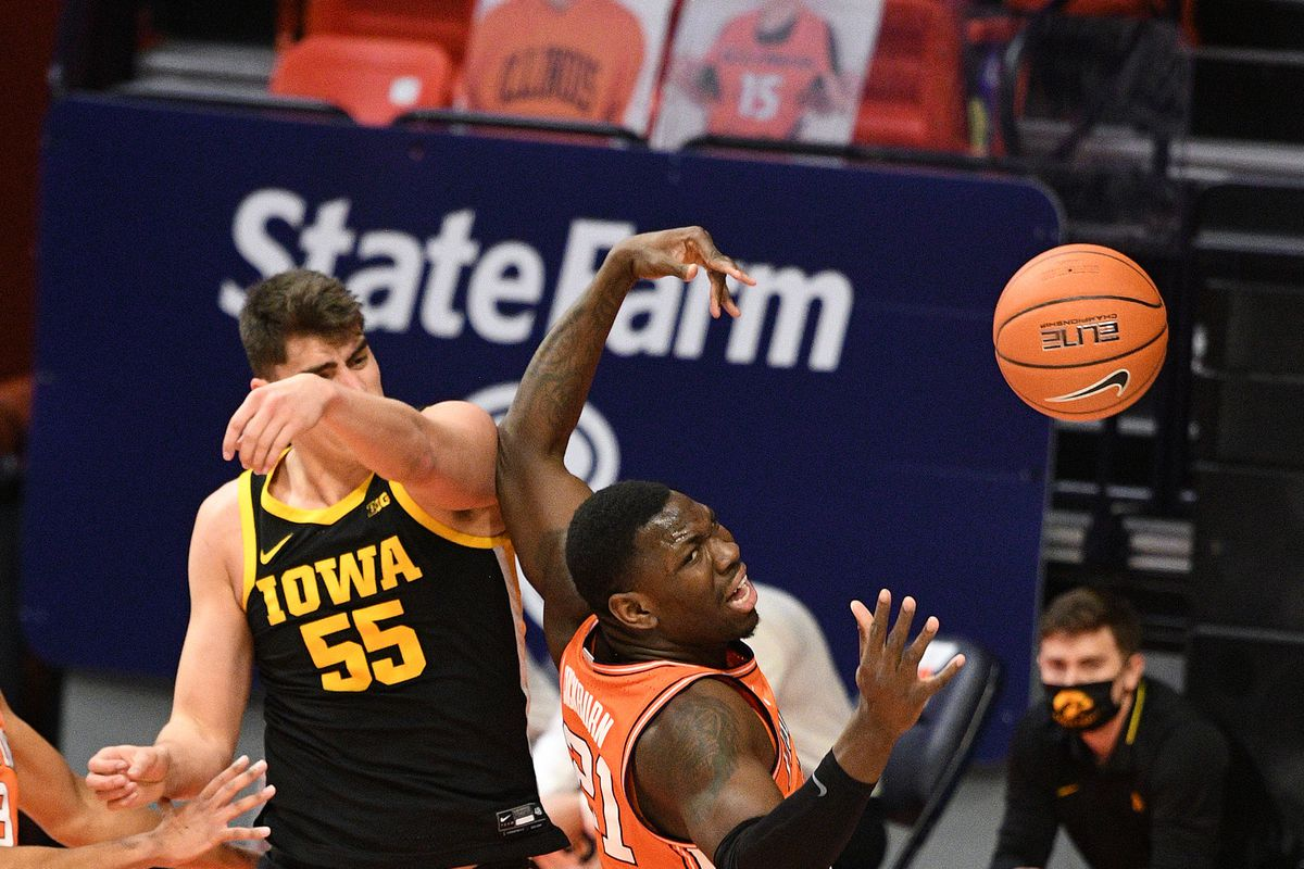 Iowa Hawkeyes center Luka Garza knocks a rebound away from Illinois Fighting Illini center Kofi Cockburn during the Big Ten Conference college basketball game between the Iowa Hawkeyes and the Illinois Fighting Illini on January 29, 2021, at the State Farm Center in Champaign, Illinois.