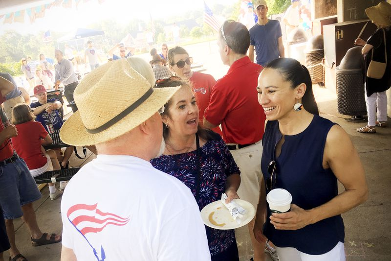 Sharice Davids, a Democrat running for Congress in Kansas, talks to supporters at a July 4 event in Prairie Village.