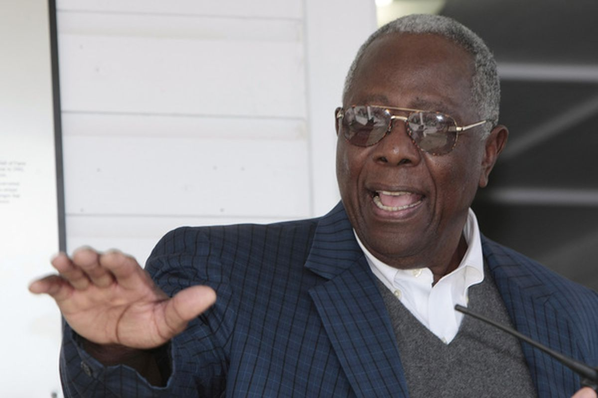 MOBILE,  AL - APRIL 14:  Hank Aaron waves to fans as he arrives prior to ceremonies opening the Hank Aaron Museum at the Hank Aaron Stadium on April 14, 2010 in Mobile, Alabama. (Photo by Dave Martin/Getty Images)