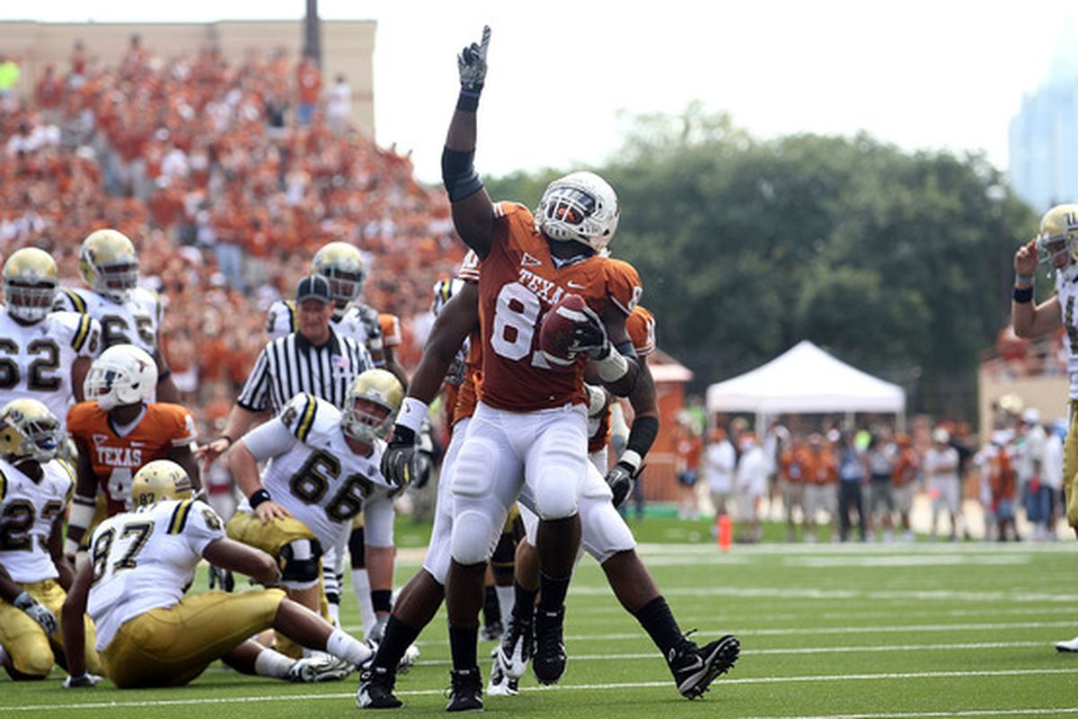AUSTIN TX:  Defensive end Sam Acho #81 of the Texas Longhorns reacts after making a fumble recovery against the UCLA Bruins at Darrell K Royal-Texas Memorial Stadium in Austin Texas.  (Photo by Ronald Martinez/Getty Images)