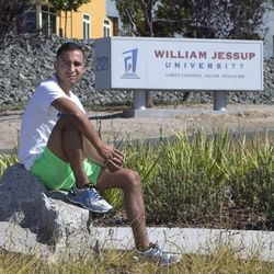In this photo taken Thursday, July 21, 2016, Anthony Villarreal poses outside of William Jessup University in Rocklin, Calif. Villarreal, had been a member of the school's cross country and track teams before he was expelled in 2013, which, he says, was because the university found out he is gay. Sen. Ricardo Lara, D-Bell Gardens introduced SB1146 which would expand state LGBT protections by removing the state's exemption for religious colleges and universities for anti-discrimination policies. (AP Photo/Rich Pedroncelli)