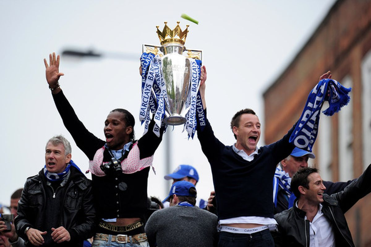 LONDON, ENGLAND - MAY 16:  Chelsea captain John Terry and Didier Drogba celebrate with the Premier League Trophy during the Chelsea FC Victory Parade on May 16, 2010 in London, England.  (Photo by Shaun Botterill/Getty Images)