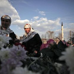 In this Wednesday March 28, 2012 photo Bulgarian Muslims lay flowers during commemoration ceremony for the victims of the communist repression,  39 years ago, in Breznitsa, some 10 km from the village of Kornitsa, Bulgaria. On March 28, 1973 police and army units stormed the village of Kornitsa and opened fire on hundreds at people gathered in the square to protest the communist regime's campaign to force Bulgaria's Muslims to adopt non-Islamic names and break up their communities. The brutal crackdown left five men dead and more than 100 wounded. More than 70 families were forced to leave their homes and settle in remote villages.