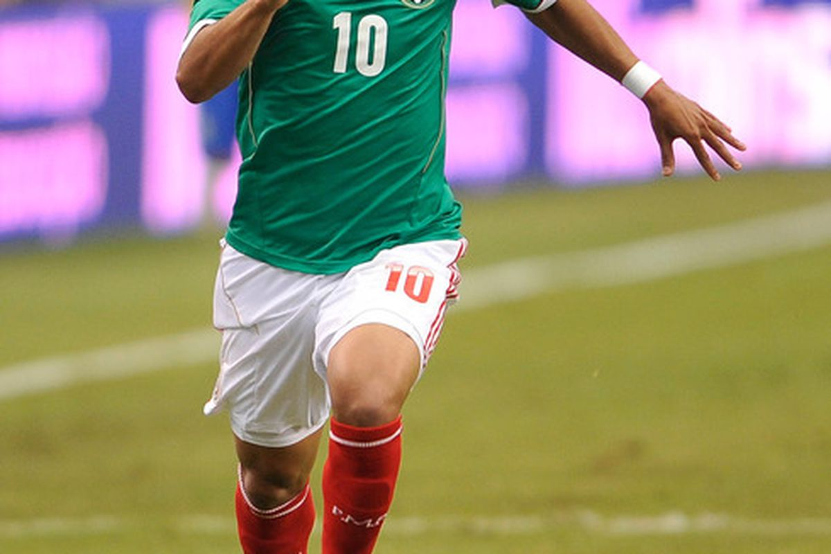 Jun 3, 2012; Arlington, TX, USA; Mexico forward Giovani dos Santos (10) chases the ball during the second half against Brazil at Cowboys Stadium. Mexico shut out Brazil 2-0. Mandatory Credit: Jerome Miron-US PRESSWIRE