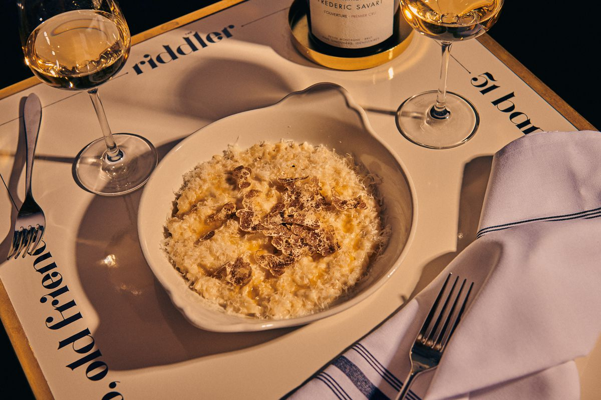 Shaving of white truffle lie atop risotto with parmesan