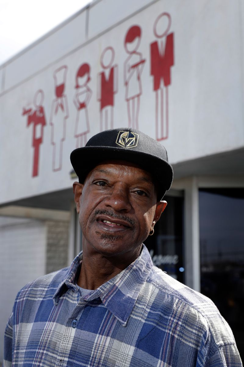A man in a black cap and checked shirt poses outside the Culinary Union hall.