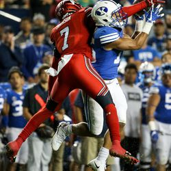 Utah Utes defensive back Jaylon Johnson (7) breaks up a pass intended for Brigham Young Cougars wide receiver Aleva Hifo (15) at LaVell Edwards Stadium in Provo on Saturday, Sept. 9, 2017.