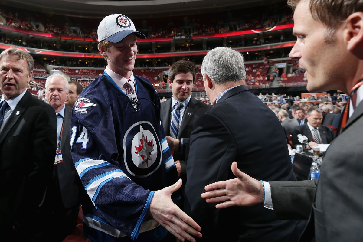 Minnesota sophomore D Jack Glover at last year's NHL Draft, where he was selected 69th overall by Winnipeg. Nice.
