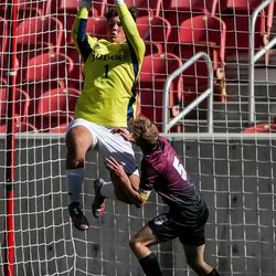 Judge Memorial goalkeeper Kolby Sessions makes a save in the 3A boys soccer championship against Morgan at Rio Tinto Stadium in Sandy on Tuesday, May 18, 2021.