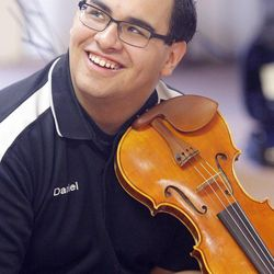 Gifted Music School orchestra student Daniel Behling has some fun during practice in Salt Lake City on April 13.