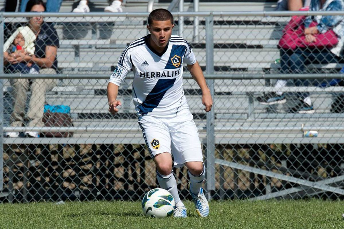 Raul Mendiola dribbles in the Dallas Cup. Today the LA Galaxy announced he's signed a Homegrown Player contract