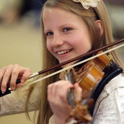 Gifted Music School orchestra student Karen Ferry has some fun during practice in Salt Lake City on April 13.