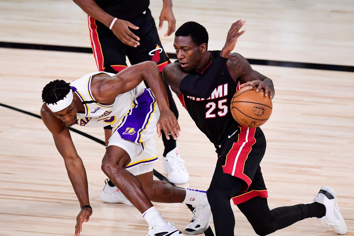 Kendrick Nunn #25 of the Miami Heat drives the ball against Rajon Rondo #9 of the Los Angeles Lakers during the second quarter in Game Six of the 2020 NBA Finals.