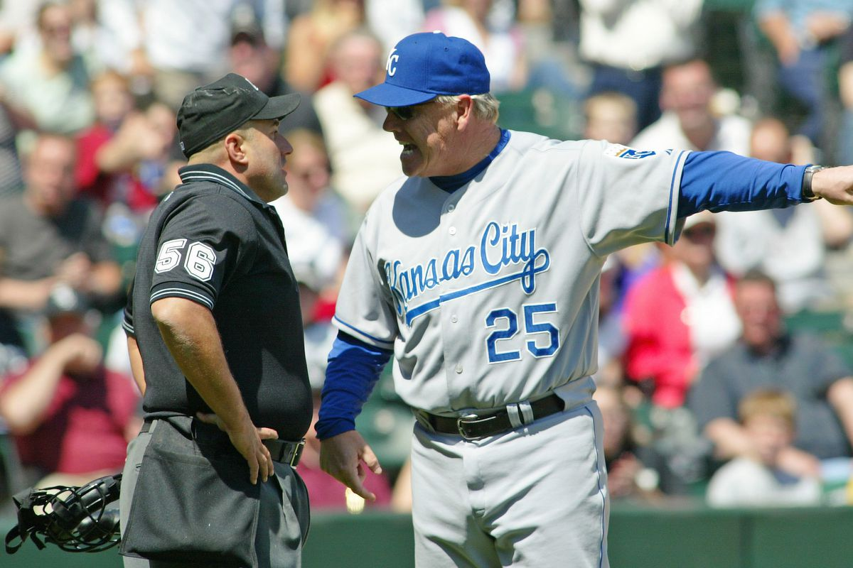 Kansas City Royals' manager Buddy Bell gets his licks in with umpire Eric Cooper after Mark Grudzielanek was called out on strikes during their game against the Chicago White Sox May 7, 2006 at U.S. Cellular Field in Chicago, Illinois.