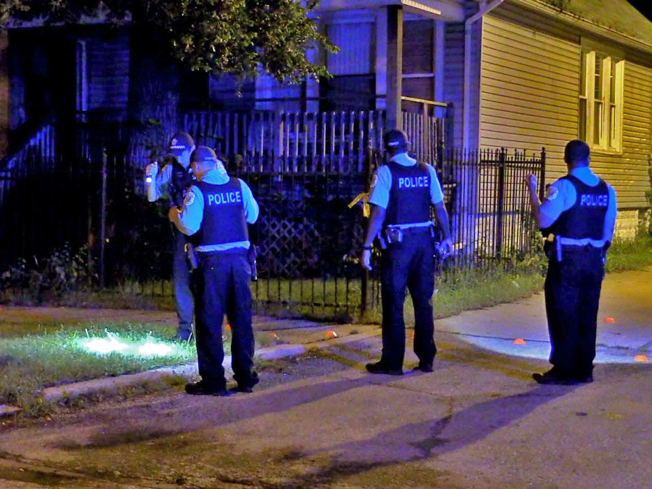 Police investigate a shooting about 10:30 p.m. Saturday, July 21, 2018 in the 200 block of West 106th St in Chicago.   Justin Jackson/ Sun-Times