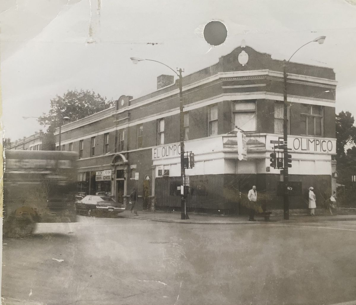 An old photograph of a corner building