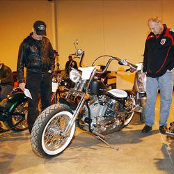 Joe Morin, left, and Russ Jensen look over a Swift Lucky Strike motorcycle at the U.S. marshals auction Thursday. The marshals held an auction to sell off the $6 million worth of cars, boats and motorcycles of Jeffery Mowen, who is accused of operating a Ponzi scheme.