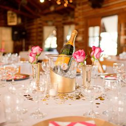 """""""I loved our table settings! I really wanted a chevron napkin and couldn't find them anywhere so Ben and I found fabric online and made all the napkins! We also wanted to give everyone horseshoes for 'good luck,' so we spray painted them gold and used the"""