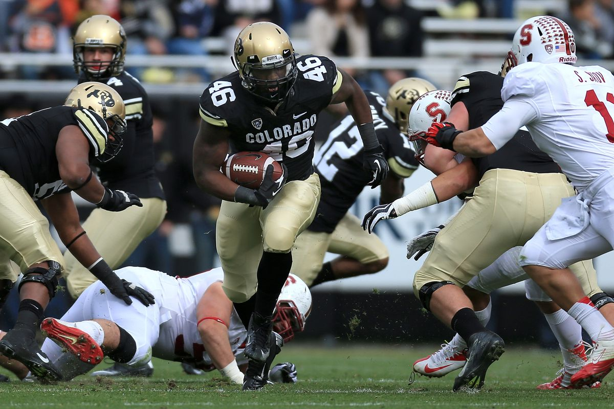 BOULDER, CO - NOVEMBER 03: Fullback Christian Powell #46 of the Colorado Buffaloes rushes against the Stanford Cardinals at Folsom Field on November 3, 2012 in Boulder, Colorado.
