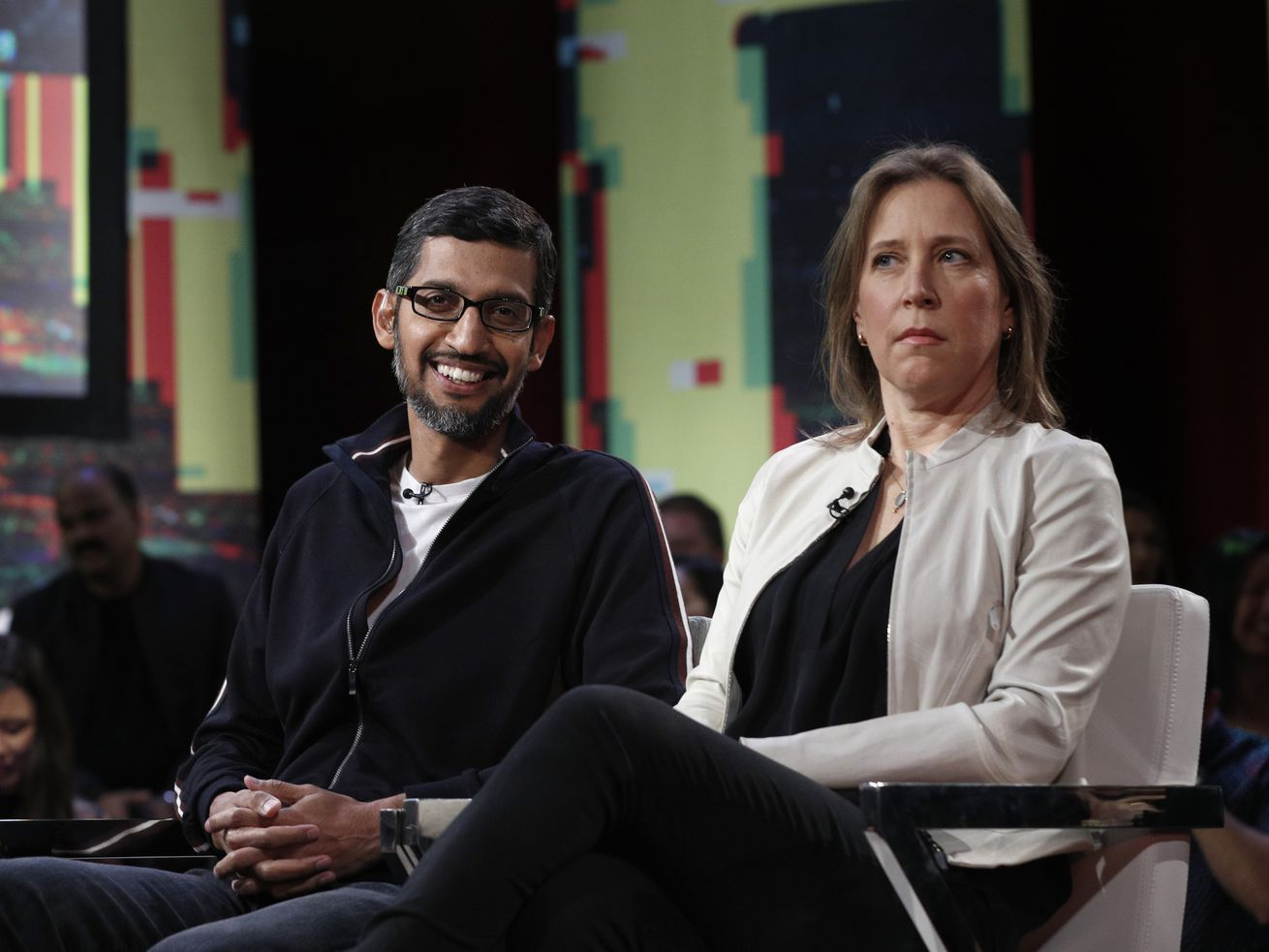 Co-hosts Ari Melber, of MSNBC and Kara Swisher with Recode talk with Google CEO Sundar Pichai, (left) and YouTube CEO Susan Wojcicki participate in an MSNBC/Recode Town Hall event at the Yerba Buena Center for The Arts on Friday, Jan. 19, 2018 in San Fr