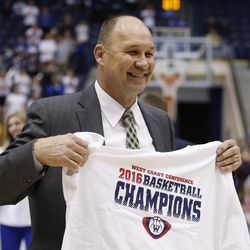 Brigham Young Cougars head coach Jeff Judkins celebrates the win over the San Diego Toreros in Provo Thursday, Feb. 18, 2016. BYU won 68-60 and captured the West Coast Conference championship.